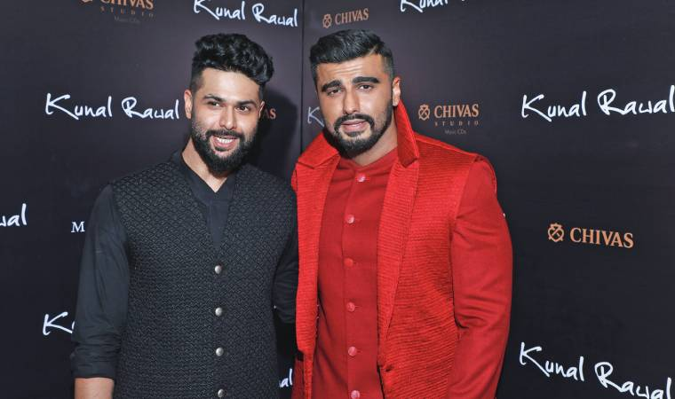 After his stores at Kala Ghoda Mumbai and Hyderabad, avant-garde menswear designer Kunal Rawal celebrated the launch of his flagship in the Capital, at DLF Emporio mall, with a showcase of his Winter-Festive 2019 collection, 'Confluence', with friend and actor Arjun Kapoor as showstopper