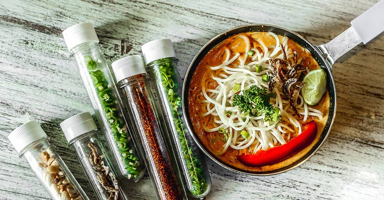 Garnishes for khow suey come in test tubes at Mumbai's Grandmama's Cafe