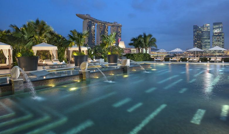 Pool and cabanas by day at the Mandarin Oriental Singapore