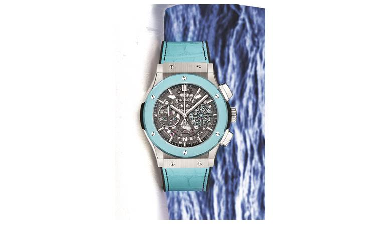 The sky blue ceramic bezel is matched with coordinated blue alligator straps and black rubber with black stitching.