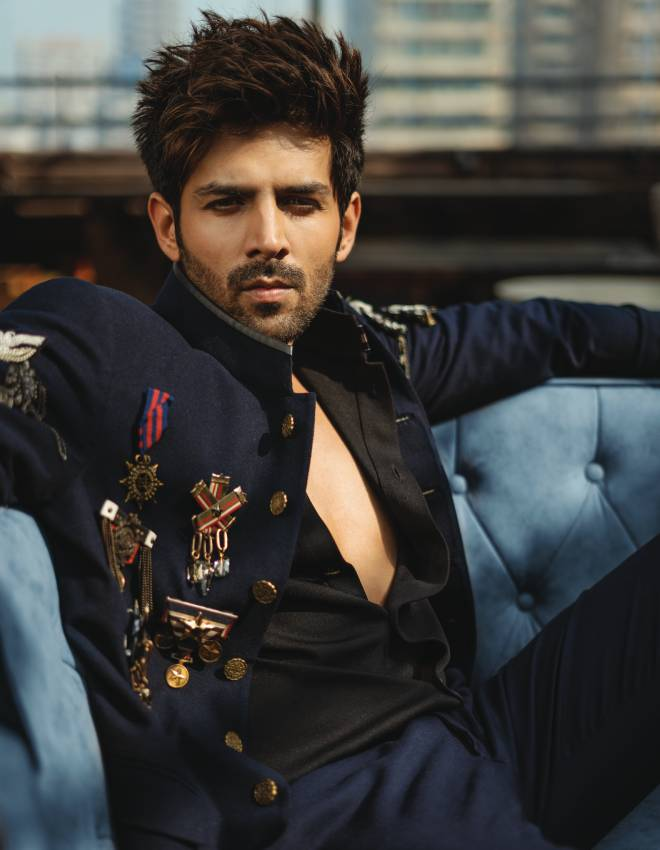 Classic navy bandhgala with leather trims and intricate metallic buttons  styled with a cluster of handcrafted medallion and chain detailed brooches paired with shirt and trousers, Shantanu & Nikhil