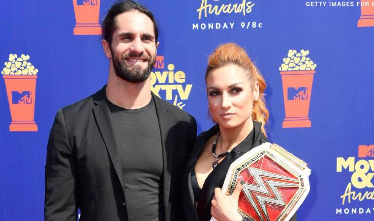 Becky Lynch with Seth Rollins